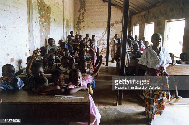 Congolese children attend class inside a crowded classroom Kinshasa Democratic Republic of the Congo 2003 Photo taken during the National Film Board...