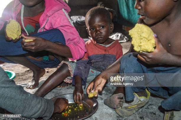 Congolese children have a meal on the floor in Goma Democratic Republic of Congo on October 10 2019 While more than 820 million people worldwide...