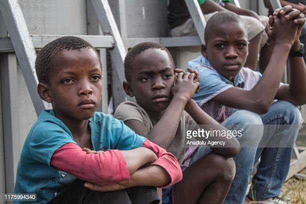 Congolese children look far away in Goma, Democratic Republic of Congo on October 10, 2019. While more than 820 million people worldwide struggle...