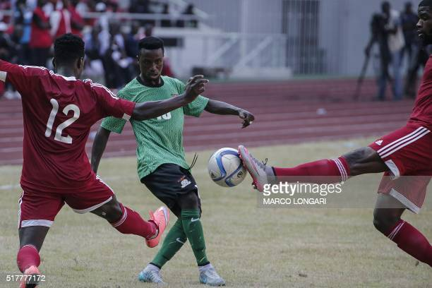 Congolese defender Arnold Davy Bouka Moutou and Congolese midfielder Jordan Hilvy Mondesir Massengo. Try to contrast Zambian left winger Lubambo...