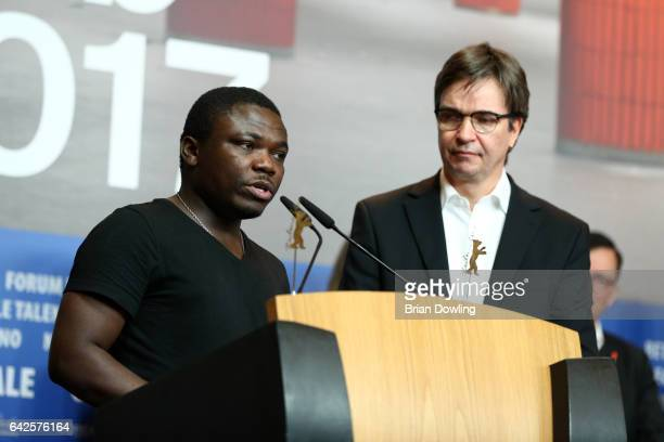 Congolese director Dieudo Hamadi and President of the ecumenical jury Charles Martig speak at the awards of the Independent Juries press conference...