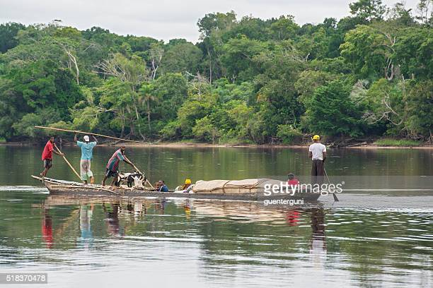 Congolese family in their pirogue on Congo River
