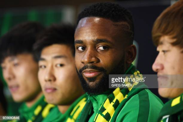 Congolese football player Cedric Bakambu smiles as he is introduced at a press conference by his new team Beijing Guoan in Beijing on March 1 2018...