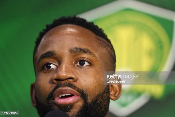 Congolese football player Cedric Bakambu speaks as he is introduced at a press conference by his new team Beijing Guoan in Beijing on March 1 2018...