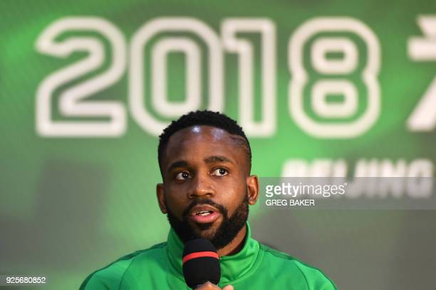 Congolese football player Cedric Bakambu speaks at a press conference by his new team Beijing Guoan in Beijing on March 1 2018 Chinese Super League...