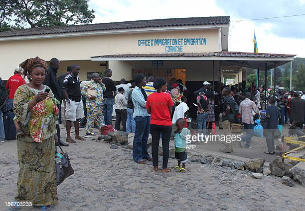 Congolese from Goma wait at the immigration office in the Rwandan border town of Gisenyi on November 18, 2012 as they seek to leave the eastern D.R....