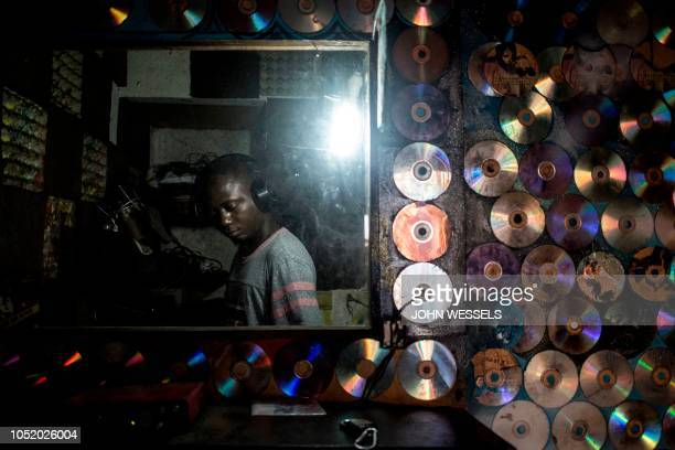A Congolese hiphop enthusiast sings inside Kinshasound one of Kinshasa's few local recording studios on October 2 2018 in Kinshasa in the Democratic...