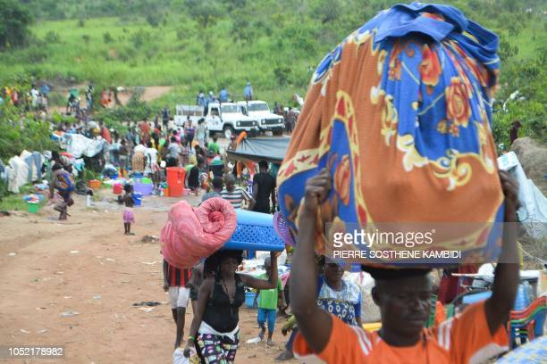 Congolese migrants who were living in Angola gather near the Congolese border town of Kamako on October 12 after returning to their country following...