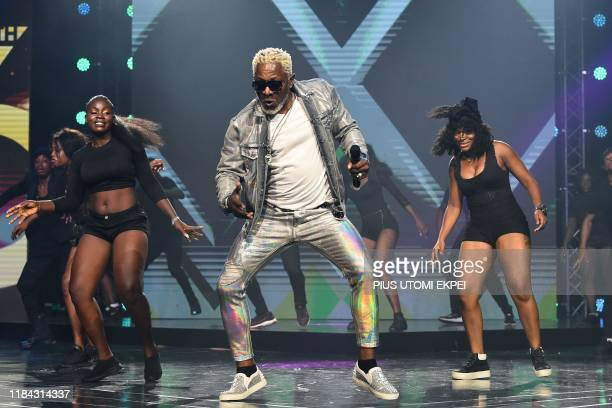 Congolese musician Awilo Longomba performs during the yealy All Africa Music Awards in Lagos on November 24 2019 The All Africa Music Awards is...
