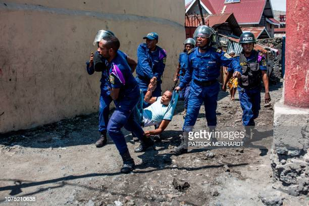TOPSHOT Congolese National Police arrest a man at Majengo neighborhood in Goma on December 27 during a demonstration against the postponement...
