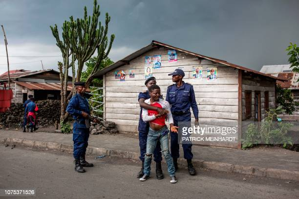 Congolese National Police arrest a man on December 28, 2018 at Majengo in Goma, in North Kivu province. - One of the world's powder-keg countries...