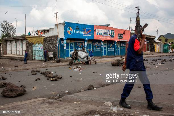 Congolese National Police patrol the street on December 28, 2018 at Majengo in Goma, in North Kivu province. - One of the world's powder-keg...