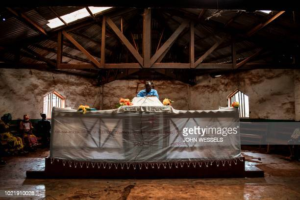 Congolese pastor prays during a church service on August 19 2018 in Mangina Sixtyone people have died in the latest outbreak of Ebola in the...