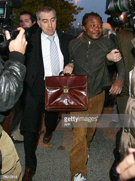 Congolese Patrick Lumumba Diya with his lawyer Carlo Pacelli leaves the police headquaters in Perugia 20 November 2007 An Italian judge ordered his...