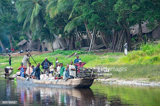 congolese people travelling in a pirogue on congo river - democratic republic of the congo stock photos and pictures