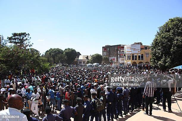 Congolese police face supporters of Congolese former governor of mineralrich Katanga province and presidential candidate Moise Katumbi as he arrives...