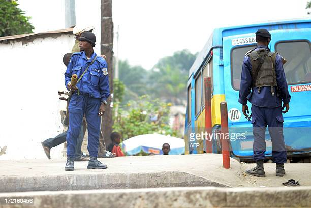 Congolese police stand guard after an incident at the Makala jail in Kinshasa on July 2, 2013. Riots also erupted earlier today at the Beni jail,...