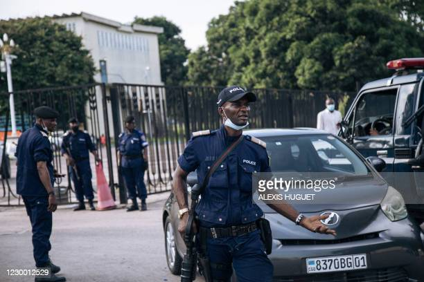 Congolese policemen are seen outside the Parliament in Kinshasa on December 8, 2020. - The police were deployed Tuesday in the Parliament of the...
