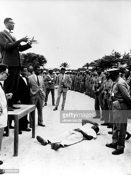 PATRICE LUMUMBA Congolese political leader Prime Minister Lumumba delivering a speech in Stanleyville Congo 19 July 1960 A Congolese citizen lies...