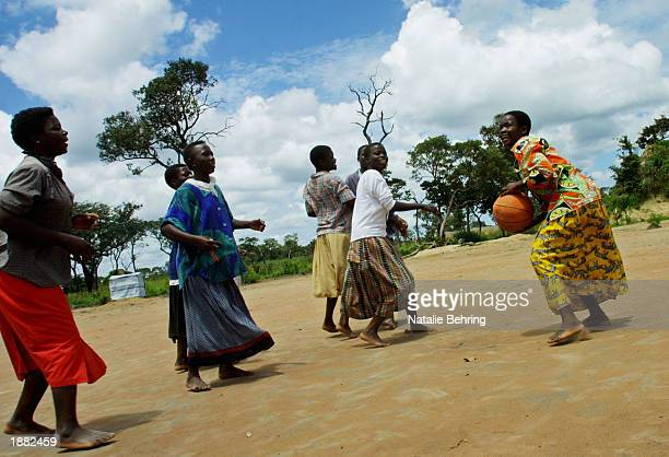 Congolese refugee girls paly a game of basketball in the schoolyard of a secondary school March 25 2003 in the Kala refugee camp near Kawamba Zambia...