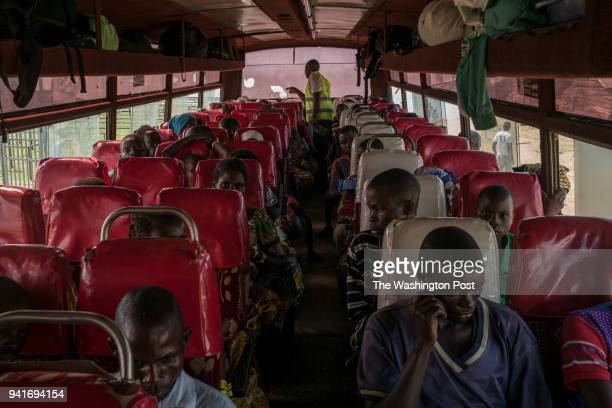 Congolese refugees are counted by a UNHCR worker after boarding a bus bound for Kyangwali refugee settlement camp after landing in Sebagoro Uganda on...