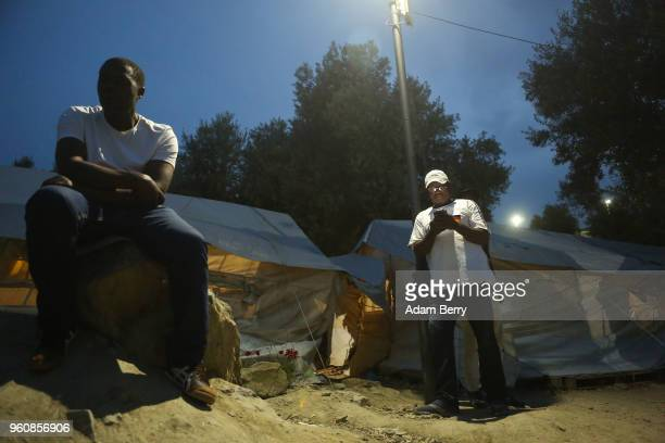 Congolese refugees use a Wifi hotspot at the Moria refugee camp on May 20 2018 in Mytilene Greece Despite being built to hold only 2500 people the...