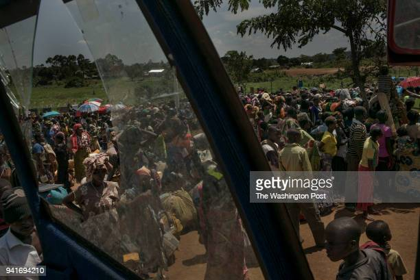 Congolese refugees wait at a reception center to be assigned to a specific area in Kyangwali refugee resettlement camp in Uganda on March 23 2018...
