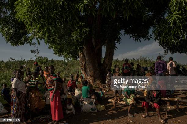Congolese refugees wait to be assigned a space in the Kyangwali refugee resettlement camp in Uganda on March 23 2018 Violence in Ituri Province in...