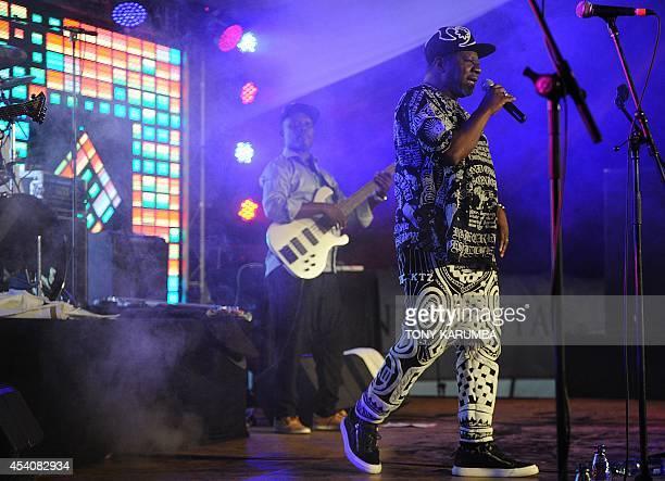 Congolese rhumba artist Papa Wemba born Jules Shungu Wembadio Pene Kikumba delivers a performance on August 24 2014 during the Koroga musical...