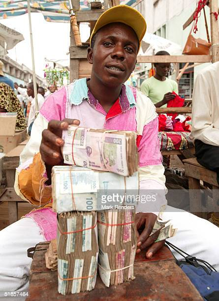 Congolese salesman changes money at the Central Market in Kinshasa on December 13 at DRC A government spokesman has denied that rival army factions...