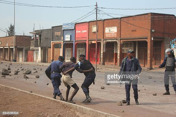 """Congolese security forces take a protester into custody as Congolese people protest Supreme Court's decision about """"In case of election postponement,..."""