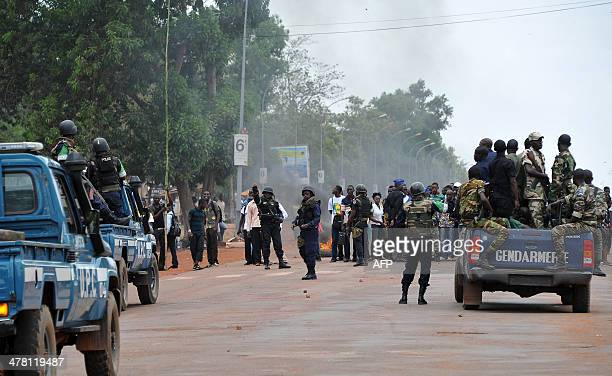 Congolese soldiers from Misca Centrafrican Gendarmerie and police members patrol on March 12 2014 in Bangui as students demonstrate to ask for the...