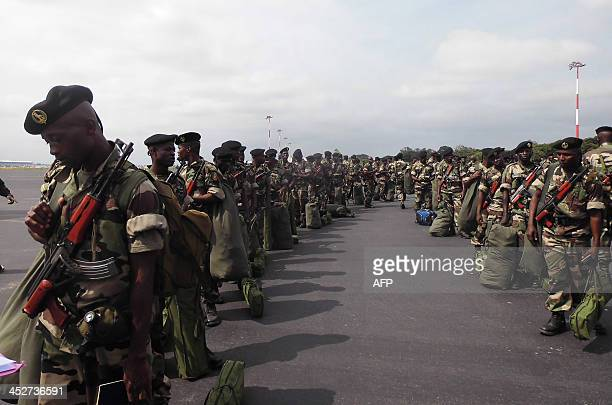 Congolese soldiers of the AfricanUnionled peacekeeping mission known as MISCA stand on the tarmac at the aiport in Brazzaville prior to be deployed...