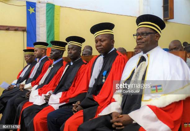 Congolese Special Prosecutor Toussaint Mutazini sits with the five other judges of the Special Penal Court on June 30 2017 at the National Assembly...