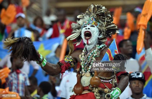 A Congolese supporter cheers for his team ahead of the 2015 African Cup of Nations semifinal football match between Democratic Republic of the Congo...