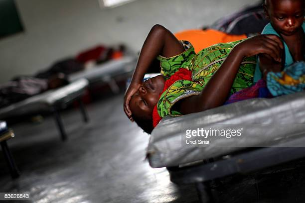 A Congolese woman and her baby ill with Cholera receive treatment in a clinic at the Don Bosko orphanage November 10 2008 in the town of Goma Congo...