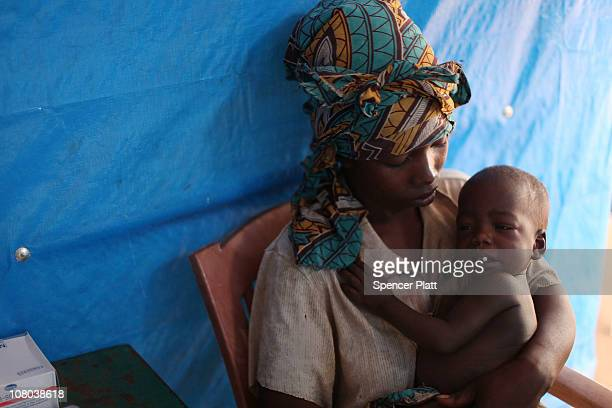 Congolese woman and her child with malaria speak with a doctor at the Makpandu refugee camp January 14 2011 outside of the town of Yambio south Sudan...
