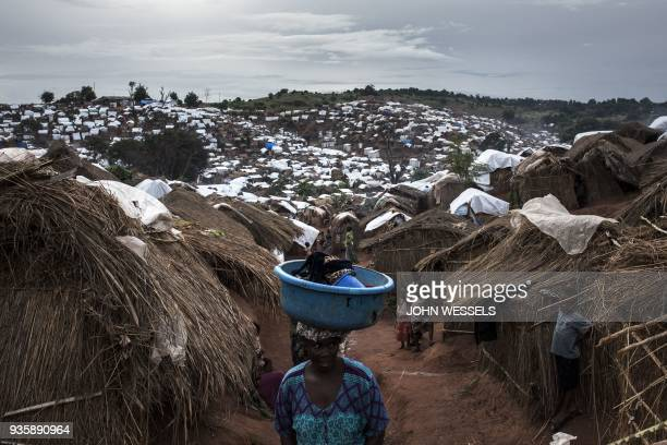 Congolese woman walks through a camp for Internally Displaced Persons on March 20 2018 in Kalemie Democratic Republic of the Congo An ongoing...