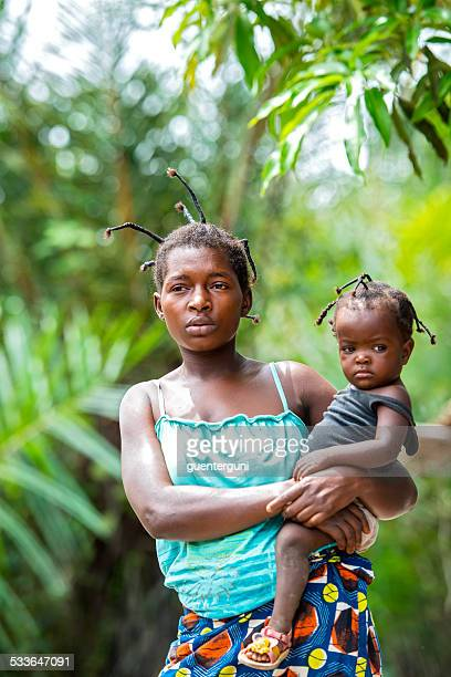 congolese woman with her baby - democratic republic of the congo stock photos and pictures