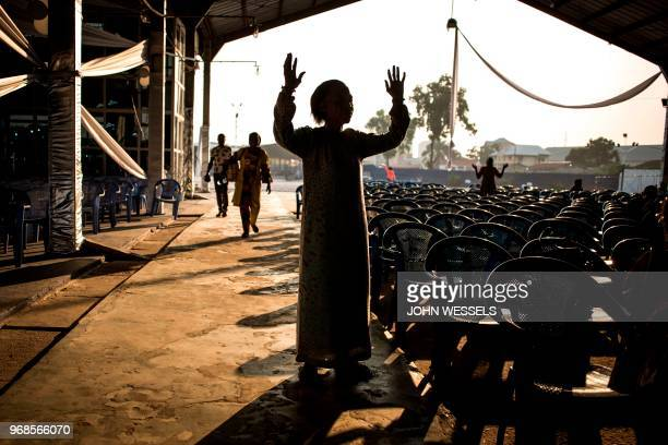 Congolese worshipper is seen during a prayer session at the Christian Ministry of Spiritual Combat on June 6 2018 in Kinshasa Kinshasa mourns a...