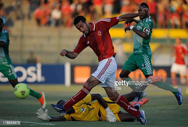 Congo's AC Leopards Goalkeeper Lawrence Ngome Ngoe tries to defend against Egypt's AlAhly player Mohammed Abu Trika during their CAF Champions League...