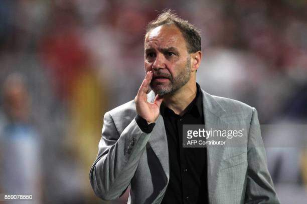 Congo's coach Sebastien Migne reacts during their World Cup 2018 Africa qualifying match between Egypt and Congo at the Borg elArab stadium in...