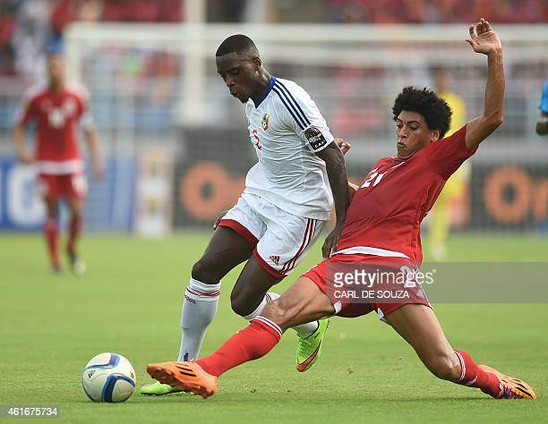 Congo's defender Arnold Bouka Moutou vies with Equatorial Guinea's goalkeeper Carlos Mosibe during the 2015 African Cup of Nations football match...