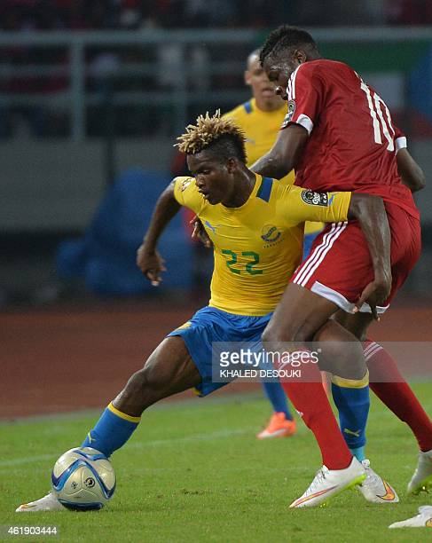 Congo's forward Ferebory Dore vies with Gabon's midfielder Ibrahim Ndong during the 2015 African Cup of Nations group A football match between Gabon...