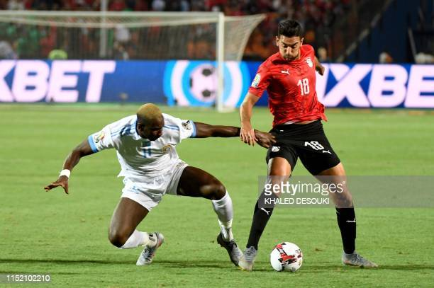 DR Congo's forward Yannick Bolasie fights for the ball with Egypt's forward Ahmed 'Kouka' Hassan during the 2019 Africa Cup of Nations football match...