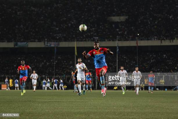 DR Congo's Jose Mpoku eyes the ball during the FIFA World Cup 2018 qualification football match between DR Congo and Tunisia on September 5 2017 in...