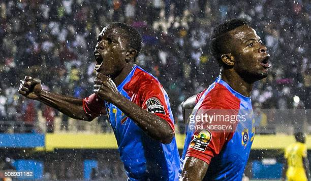 DR Congo's Mechak Elia celebrates with DR Congo's Doxa Gikanji after scoring a goal during the African Nations Championship football final match...