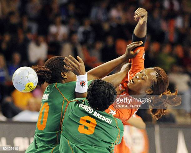 Congo's Mononga Bassarila vies with Ivory Coast's Paula Bredou and Robeace Abony on March 29 2008 in Nimes southern France during their Women...