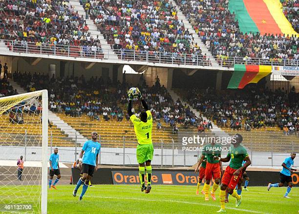 DR Congo's Muloko Kudimbana stops the ball during their friendly football match against Cameroon in Yaounde Ahmadou Ahidjo Stadium on January 7 prior...