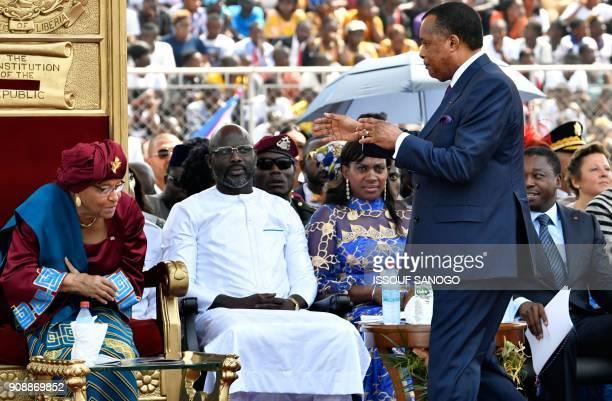 Congo's President Denis Sassou Nguesso walks past Liberia's outgoing president Ellen Johnson Sirleaf Liberia's Presidentelect George Weah his wife...